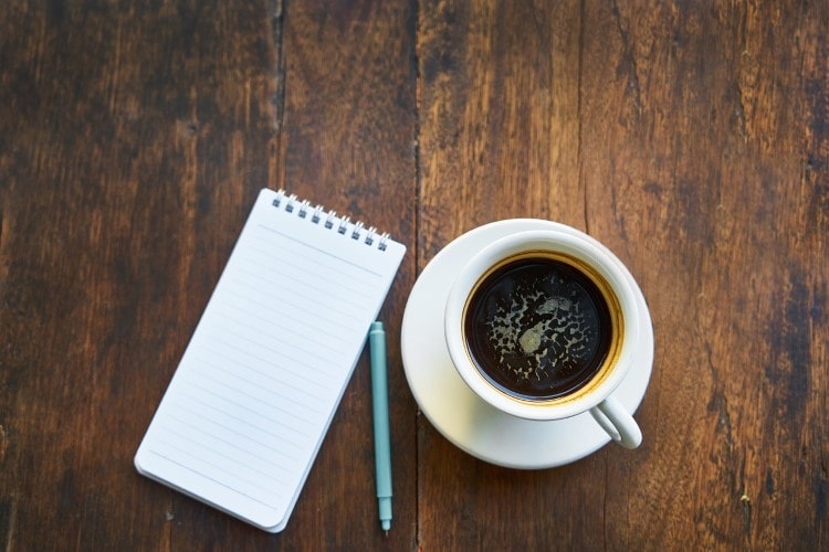 coffee-and-a-notepad-on-a-wooden-table