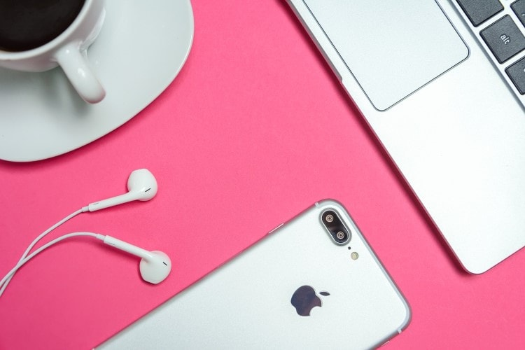 mac-products-and-a-coffee-on-a-pink-table
